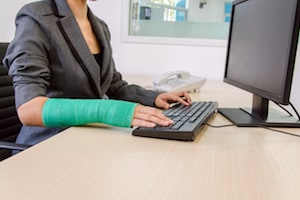 Women working with broken arm